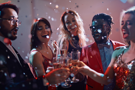 clubbers: Ecstatic clubbers toasting with champagne at party