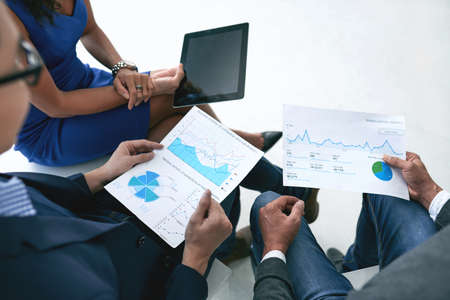 financial reports: Business people discussing financial reports at meeting Stock Photo