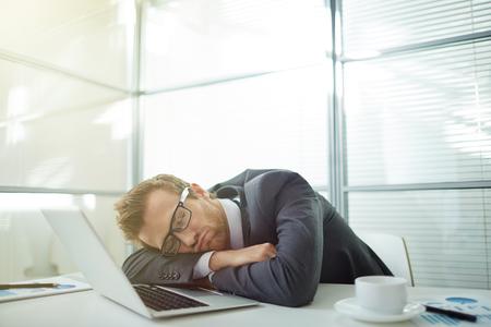 asleep: Businessman sleeping at his workplace