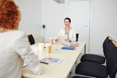 company job: Positive hr manager interviewing a new candidate Stock Photo