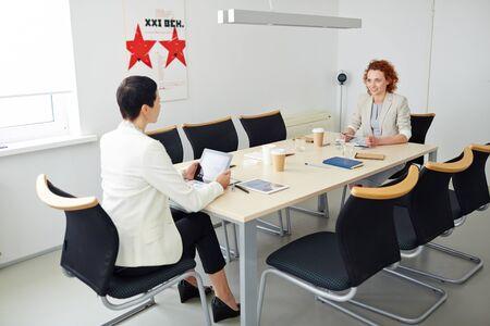 company job: Young woman at job interview in a big company