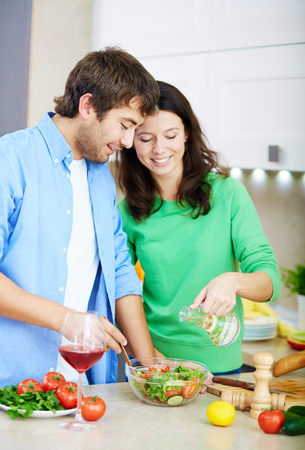 Young couple making healthy vegetarian salad