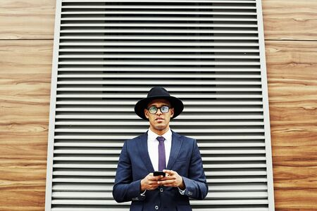 latinamerican: Portrait of latinamerican businessman with phone
