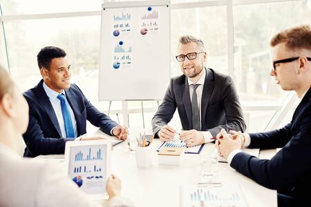 office manager: Four businesspeople meeting in office Stock Photo