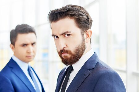 displeased businessman: Two serious businessmen looking at camera Stock Photo
