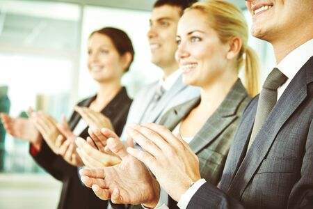 Business people clapping at conference photo