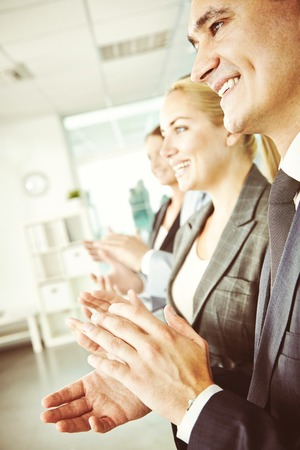 Business team applauding at conference photo