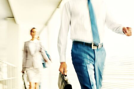 blurred people: Blurred image of moving business people
