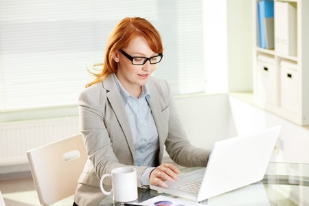 communication occupation: Young female manager working in office
