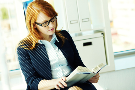 textbook: Young student reading a textbook Stock Photo