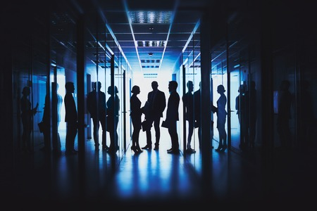 Silhouettes of business people in corridor