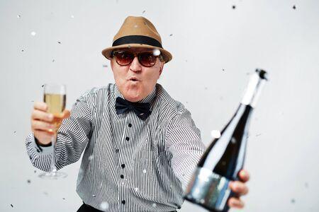 man style: Senior man toasting with champagne Stock Photo