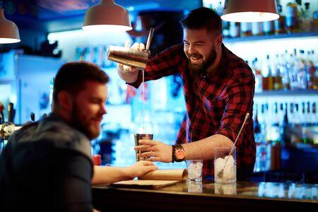 barman: Happy barman making drink for guy