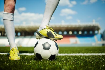 kickoff: Football player waiting for the moment of kick-off Stock Photo