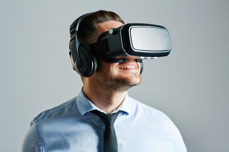 stimulator: Businessman wearing virtual realty stimulator Stock Photo