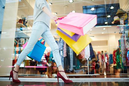 Female walking in shopping mall Standard-Bild