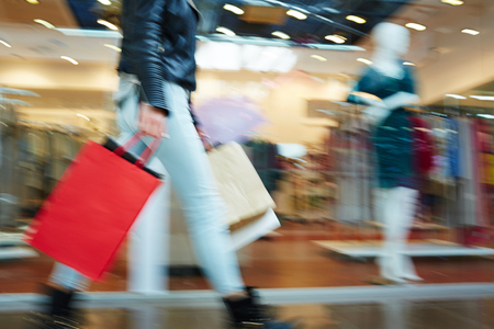 mall: Blurred image of female in shopping mall