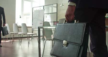 business briefcase: People entering office for the meeting