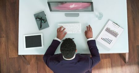 workday: Male manager using computer during his usual workday