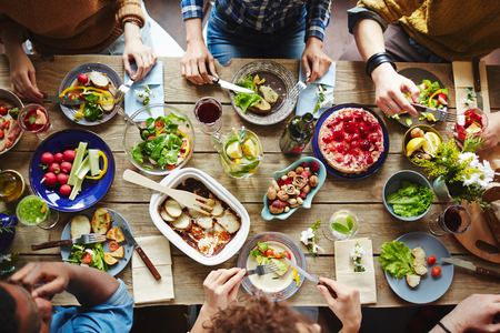 having lunch: Top view of friends having lunch Stock Photo