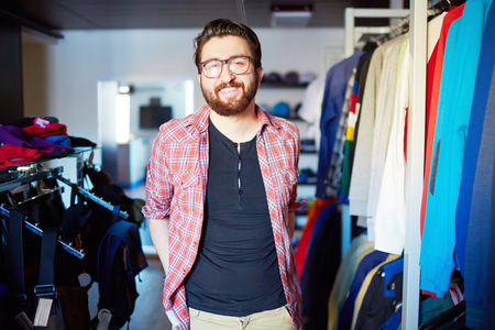 clothing shop: Portrait of male sales assistant in clothing store
