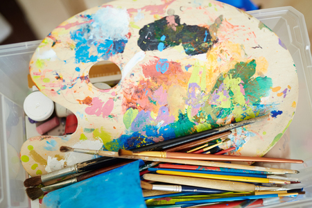paintbrushes: Palette with water-colors and paintbrushes Stock Photo