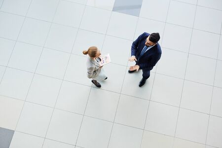 conversing: High angle view of business colleagues conversing at office
