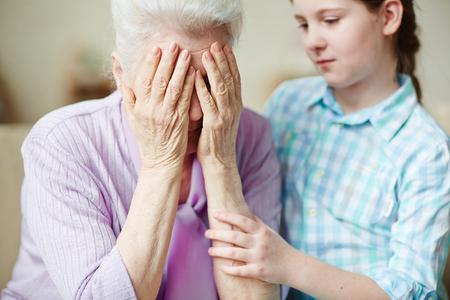 reassure: Teenage girl reassuring her grandmother