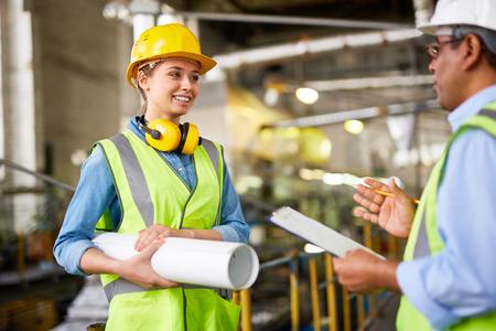woman engineer: Female engineer talking to her colleague