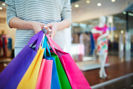 shopper: Casual shopper holding paperbags of various colors