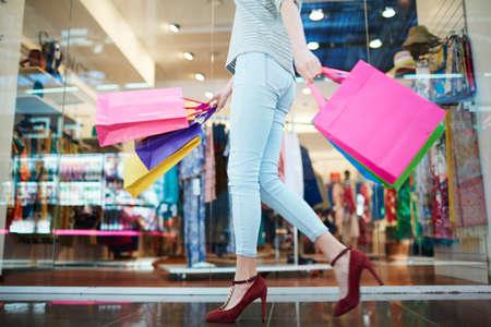 shopper: Shopper in casual-wear walking in trade center
