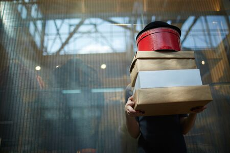 consumer: Female consumer holding boxes after shopping