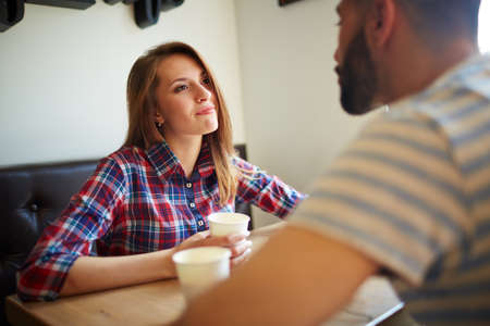 Pretty girl looknig at her boyfriend in cafe