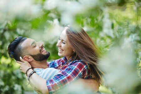 ecstatic: Ecstatic young couple enjoying time in park