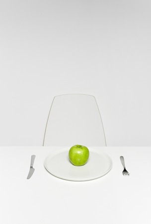 organics: Fresh green apple on plate