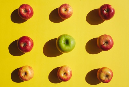 organics: Group of apples on yellow background