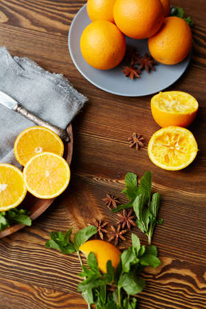 organics: Fresh oranges, mint and star anise on wooden table