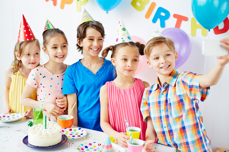 children party: Group of children taking selfie at birthday party