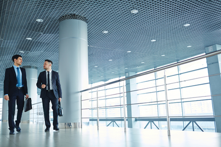 specialists: Two specialists walking down business center Stock Photo