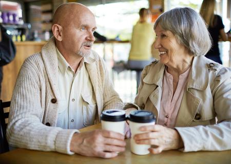 amorous woman: Romantic seniors having drink in cafe