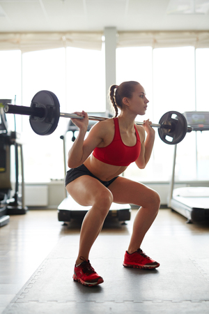 activewear: Young girl in active-wear lifting weight