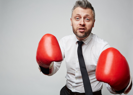 rival: Experienced employer fighting business rival Stock Photo