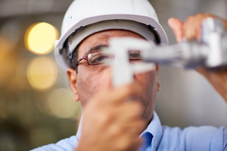 business tool: Close-up of engineer working with vernier Stock Photo