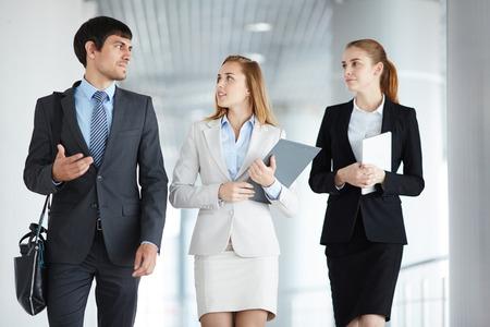 executive women: Two businesswomen listening to co-worker