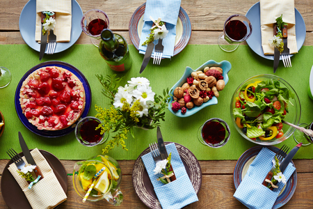 holiday gathering: Various tasty food on served table ready for guests Stock Photo