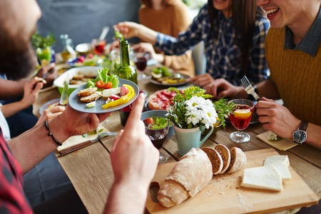Close-up of friends talking by festive table