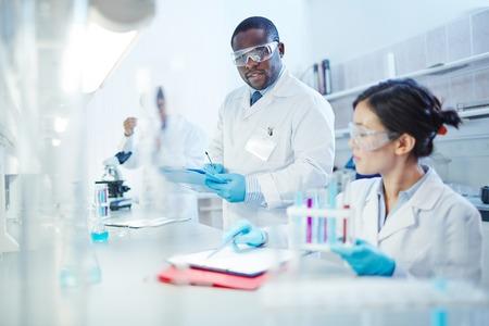 Modern scientists working in lab