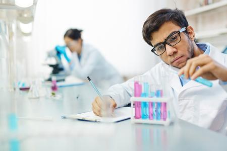 liquids: Serious scientist working with liquids in laboratory