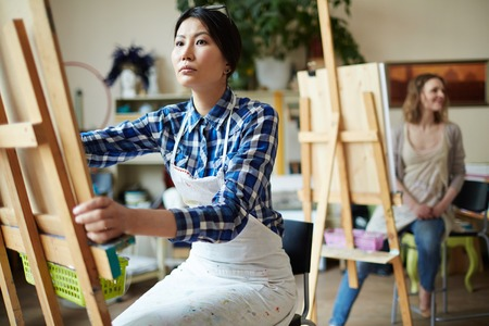 art and craft: Young woman drawing in art studio Stock Photo