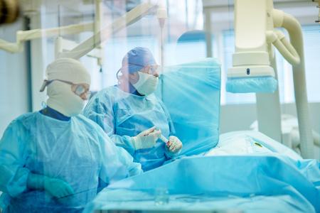 coronary: Surgeons performing coronary artery bypass grafting